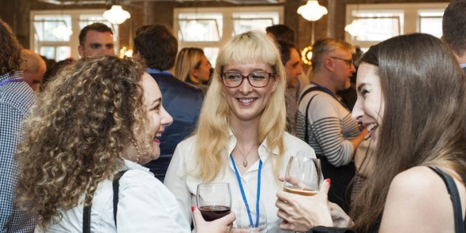 Three people enjoying networking at an event